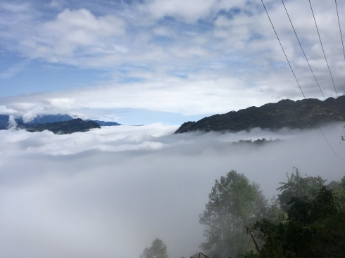 The clouds huddled below the mountains